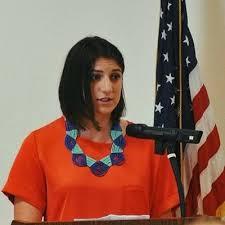 Young woman at podium